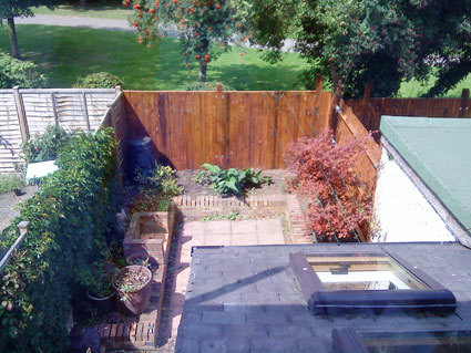 The garden with new fence in London Ealing