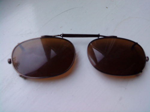 Clip-on sunglasses left at the Glass Vase Concert on 23rd May 2010