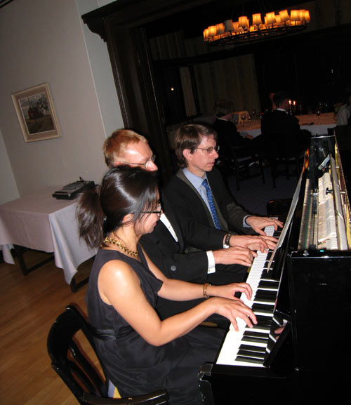 Decision scientists playing 6 hand piano music at the Helsinki Hilton