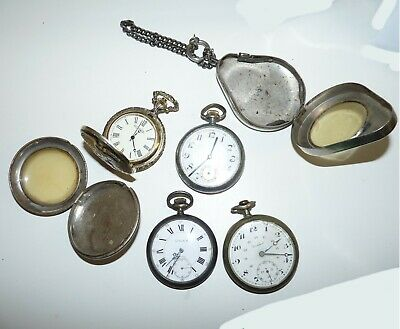 Lot of old pocket watches with vintage cases