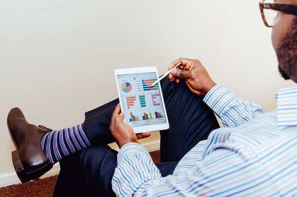 Shopify A/B testing: Man looking at graphs on a tablet