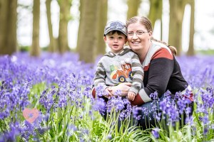 Badbury clump woodland. Little boy with his mum gemma. family portrait photographer