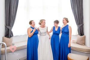 Nervous bride shares a moment with her girls pre wedding.