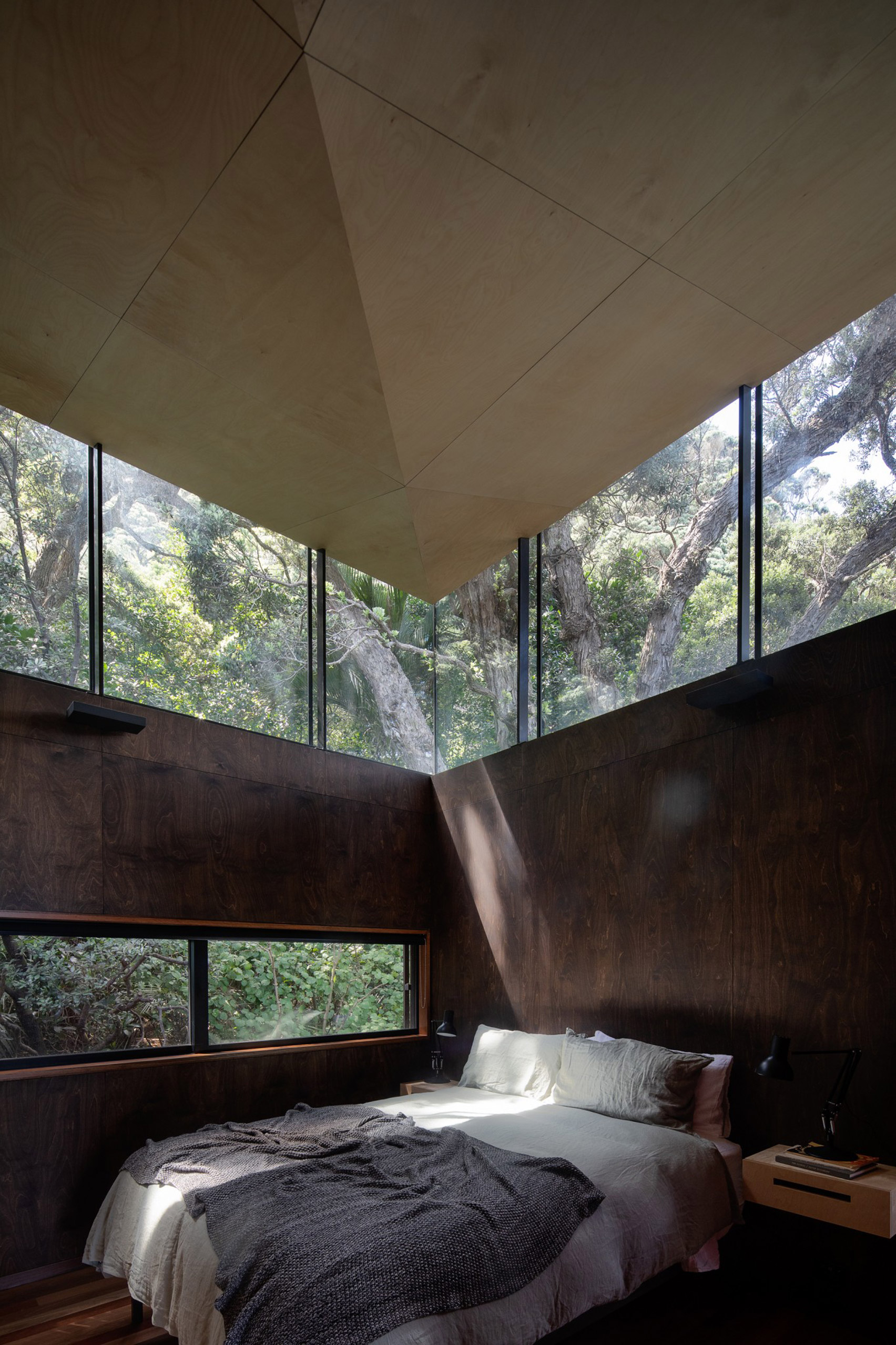 Modern design bedroom surrounded by trees