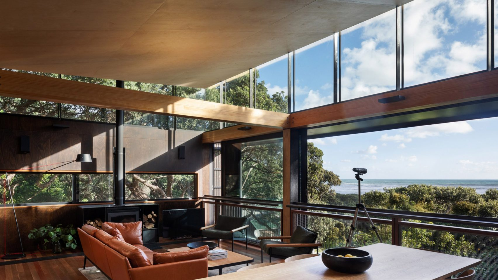House with views to the sea surrounded by trees in New Zealand