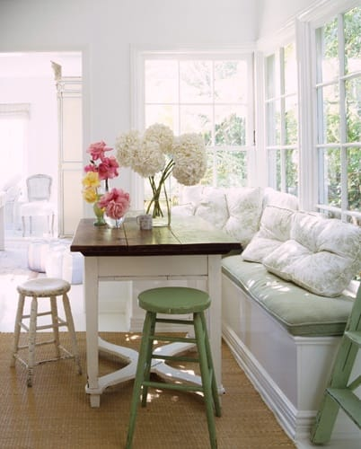 Home Nook Ideas Neutral Breakfast Nook with Fresh Flowers Colorful Bar Stools Bay Windows Hardwood Floors