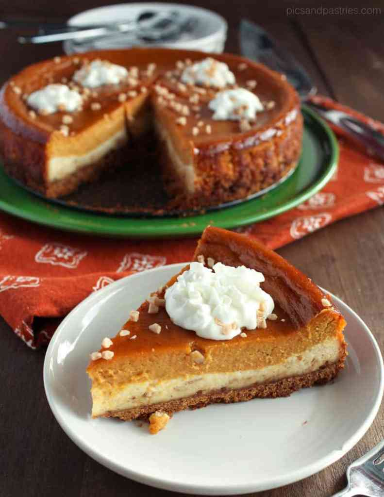 a slice of pumpkin pie toffee cheesecake with whipped cream on top