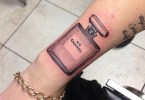 Beautiful Black Color Ink Bottle Tattoo On Wrist For Girls