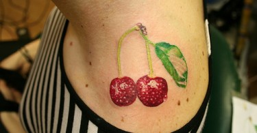 Groovy Red And Green Color Ink Cherries Tattoo Design On Neck For Girls