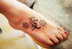 Superb Red And  Black Color Ink Chinese Love Tattoo On Foot For Girls