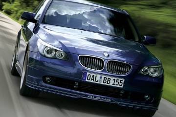 front side view of beautifull blue alpina b5 Car