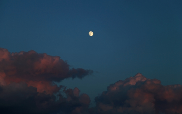 The near-full moon is seen on August 8, from Winthrop,MA