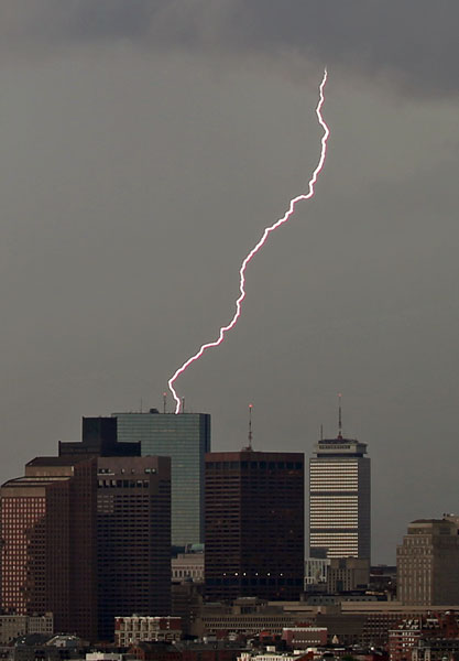 Lightning strikes over the Boston skyline, Tuesday afternoon.