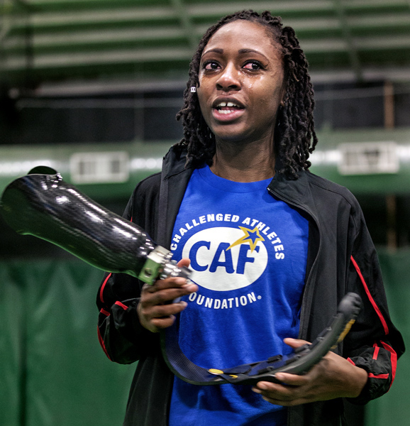 Femita Ayanbeku, age 23 years of Boston, cries as she receives a custom Ossur Flex-Run prosthetic foot at the 3rd Ossur Boston Running and Mobility Clinic, Saturday morning. She lost her leg in an accident at the age of 12,