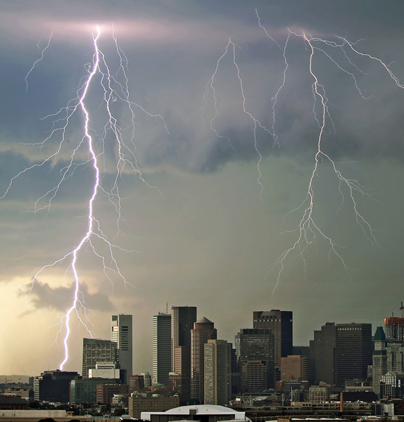 08/04/2015-Boston,MA. Lightning strikes over Boston's Financial and Seaport Districts during Tuesday afternoon's thunderstorm activity. Staff photo by Mark Garfinkel