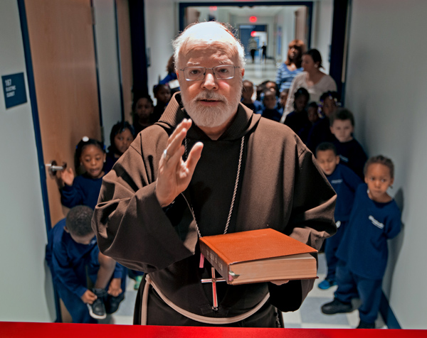 Cardinal Sean O'Malley blesses the newly re-dedicated Saint John Paul II Catholic Academy Lower Mills Campus, on Dorchester Ave