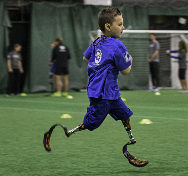 11/14/2015-Boston,MA. Braylon O'Neill, age 6 years, runs at the 3rd Ossur Boston Running and Mobility Clinic, Saturday morning.