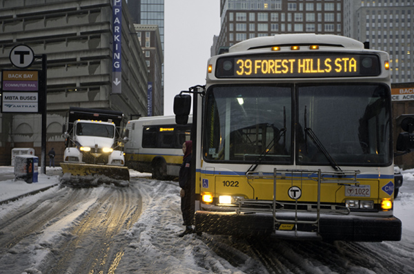 12/29/2015-Boston,MA. One of 5 MBTA elongated buses, and it's driver, standing at bus, is freed from it's stuck position during Tuesday morning's snowfall. The buses, on Clarendon St. between Columbus and St. James, were stuck for approximately one hour. Staff photo by Mark Garfinkel