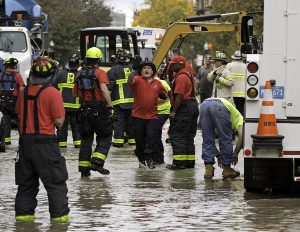 October 21, 2016-Boston,MA. Firefighters scurry into position in the first moments after a trench collapse and water leak killed 2 workers on Boston's Dartmouth street, Friday afternoon. CREDIT Boston Herald staff photo by Mark Garfinkel. NO BOSTON (Boston OUT) No sales No Mags