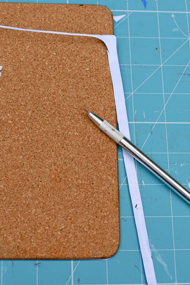 cutting excess paper with craft knife
