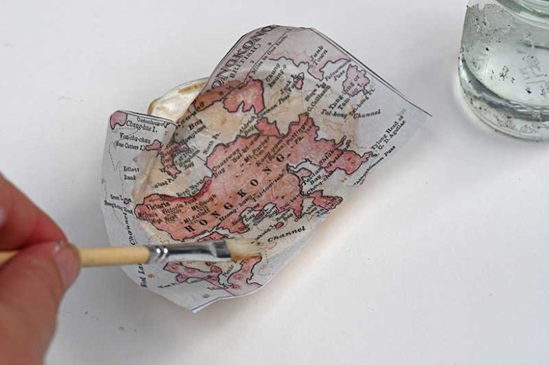 Brushing map with water