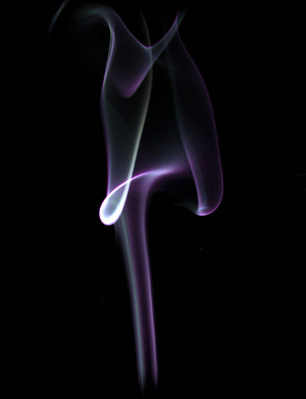 purple smoke on black background