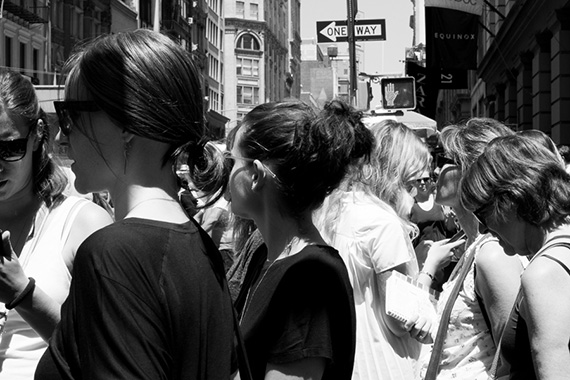 black and white street photo crowd nyc