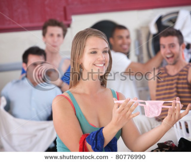 Picture Of A Pretty Young Woman Showing Her Panties In The Laundromat Around A Bunch Of