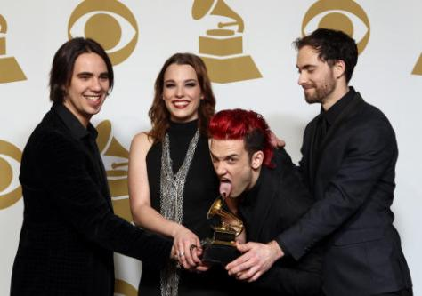 """Members of Halestorm, from left, Joe Hottinger, Lizzy Hale, Arejay Hale, Josh Smith pose backstage for the best rock album award for """"Love Bites (So Do I)"""" at the 55th annual Grammy Awards on Sunday in Los Angeles. (Associated Press)"""
