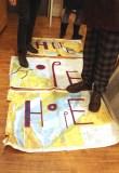 "Bob and Roberta Smith - Destruction of ""Maps of Hope,"" 2015, Destruction of paper maps, enamel paint"