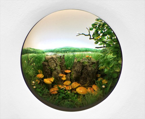 "Patrick Jacobs - ""Double Stump with Rustgill Mushrooms,"" 2015, Styrene, acrylic, cast neoprene, paper, polyurethane foam, ash, talc, starch, acrylite, vinyl film, copper, wood, steel, lighting, BK7 glass. Diorama viewed through 2.75 inch (7cm) window.  Interior box dimensions: 18.5 (W) x 12.75 (H) x 11.5 (D) inches (47 x 32 x 29 cm)"