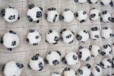 "Sermin Kardestuncer - Detail: ""301 Balls (Diptych),"" 2017, Cotton thread, coal, fabric, 37 X 37 x 1.5 inches each panel (37 x 75.5 x 1.5 inches overall) Photograph by Eric Lubrick"