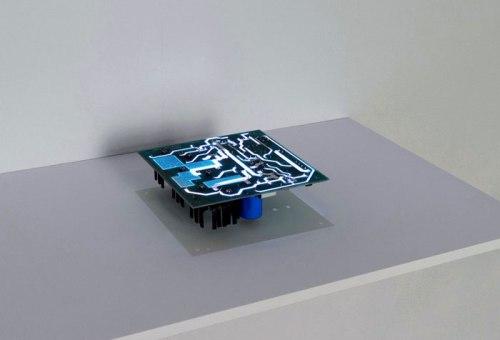 "Daniel Canogar  (bitforms gallery) - ""PCB,"" 2014, Discarded circuit board, wood, projector, multimedia player 53 x 23.6 x 15 in / 134.6 x 60 x 38 cm"