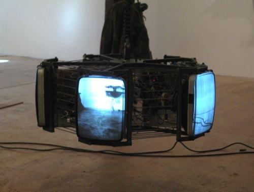 "Jonathan Schipper - ""Invisible TV,"" 2005, Steel, video cameras, security monitors, motors, 25 inches in diameter"