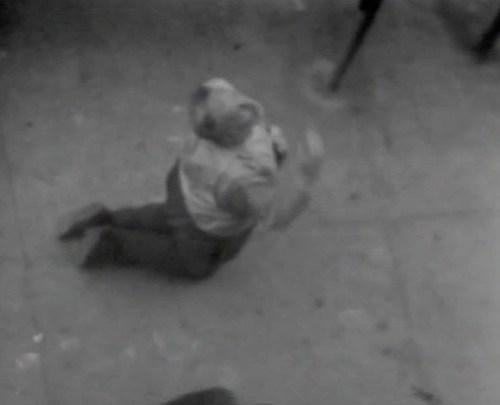 """Man Genuflecting - Still from video """"Atlantic in Brooklyn,"""" 1971-72. Collection of the artist."""