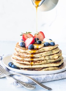 banana sourdough pancakes with drizzling syrup