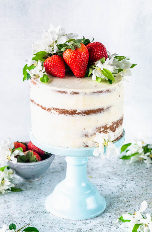 Pineapple and Strawberry layer cake topped with fresh flowers