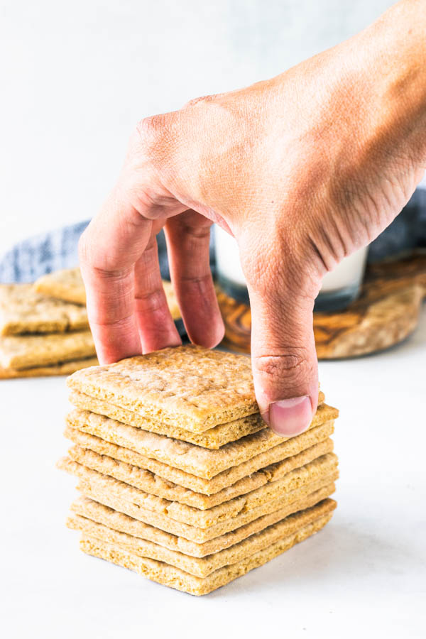 grabbing a cracker from a stack