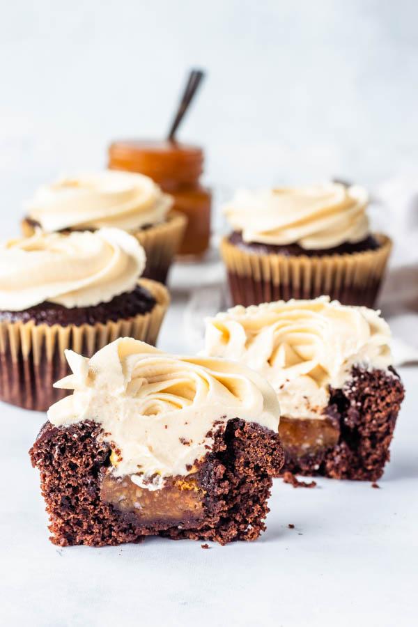 vegan caramel cupcakes filled with caramel sauce cut in half