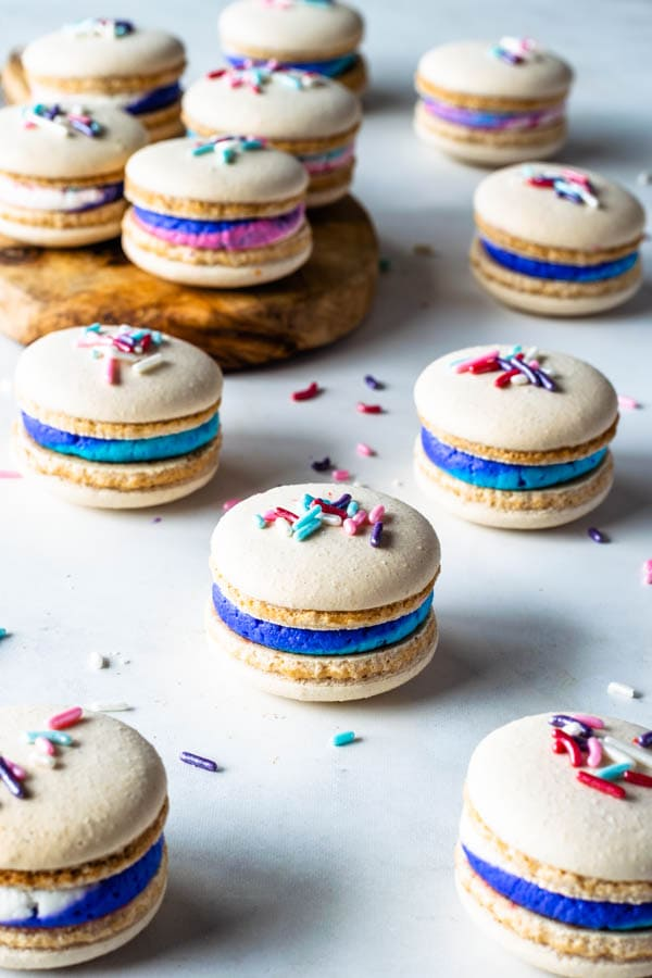 vegan vanilla macarons with sprinkles and multi-color vegan buttercream filling