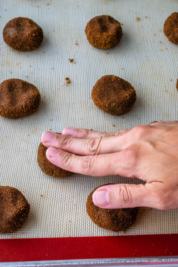 flattening cookies with fingers, to make them flatter
