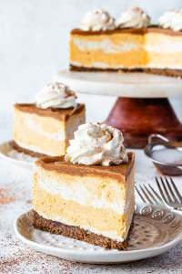 Vegan Pumpkin Cheesecake slice topped with coconut whipped cream