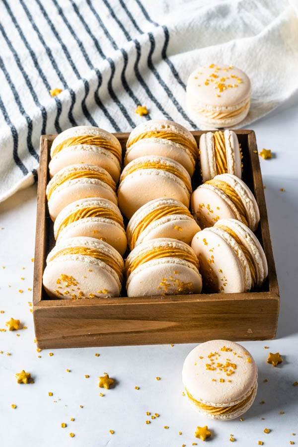 Butterbeer Macarons with Butterbeer buttercream and butterscotch ganache filling topped with gold sugar