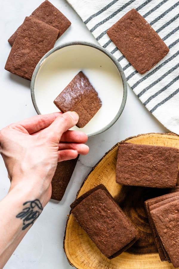 dunking chocolate cookies in milk