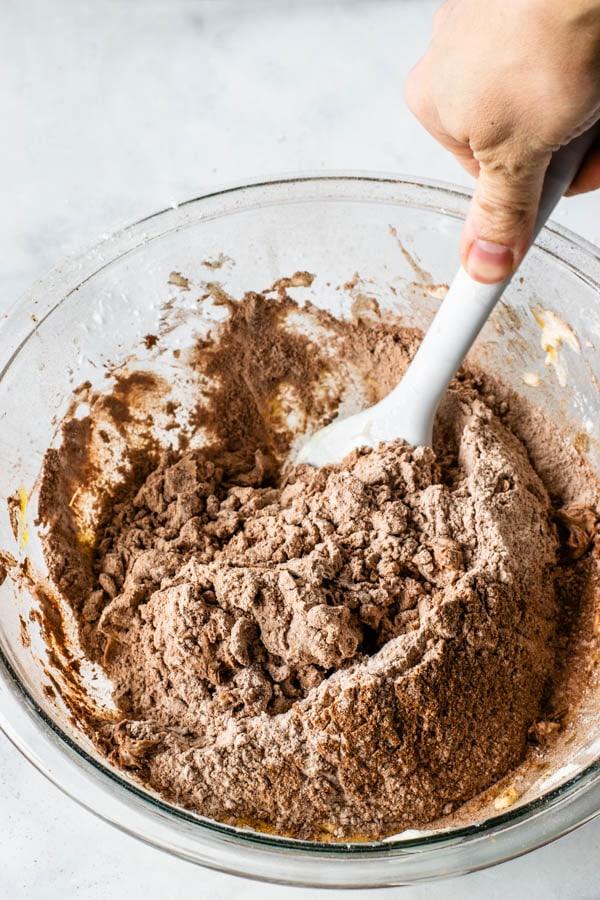 mixing dry ingredients to make chocolate tart dough