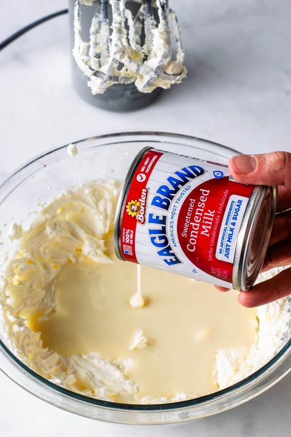 adding condensed milk to cream cheese to make no bake cheesecake