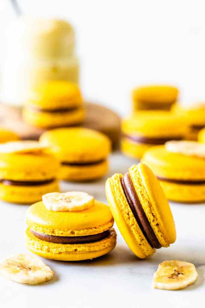Banana Macarons yellow macarons in a box with chocolate and banana pudding filling