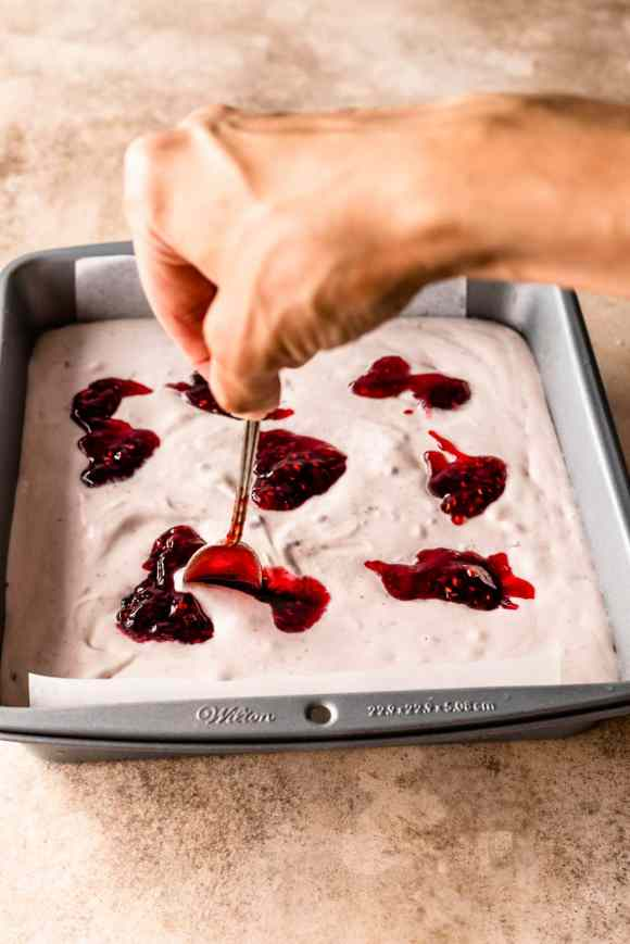 swirling raspberry jam in no-churn ice cream