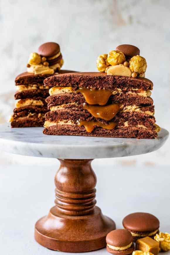macaron cake sliced in half filled with caramel.