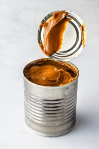 slow cooker dulce de leche made out of a can of condensed milk.
